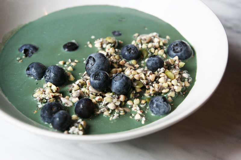 seed muesli with blue-green spirulina milk and blueberries